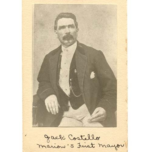 Historic photo of a man with a mustache wearing a shirt, vest with pocket watch, and jacket.